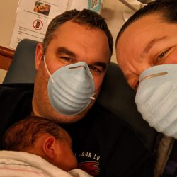 The Finne family at the hospital with their newborn, parents are wearing masks because it was the middle of the COVID-19 Pandemic