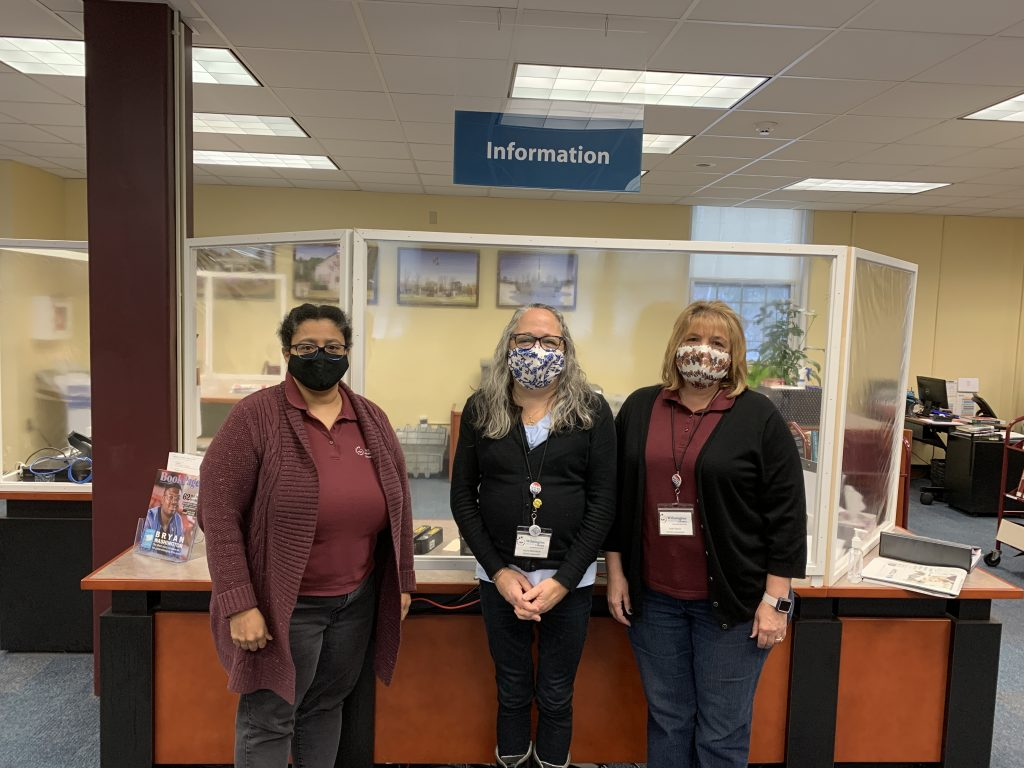 Lisa Laurie and Jean in masks in front of the circ desk