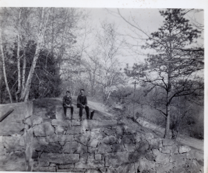 Harold Eames and Robert Carter sitting on abuttment of aquaduct of the Middlesex Canal on Shawsheen Ave at the Billerica Line. Circa 1905.