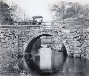 A Horse and Buggy going over the Shawsheen bridge on Shawsheen Ave near the Wilmignton/Billerica Line with the Aquaduct in the background. Circa 1905