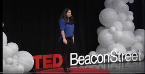 Graciela Mohamedi on the stage at Ted Talk Beacon Street